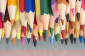 Group of sharp colored pencils with reflexions — Stock Photo
