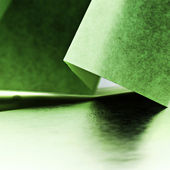 Colorful paper shapes with paper background — Stock Photo