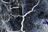 Abstract composition with cracked soil and inverted colors — Stock Photo
