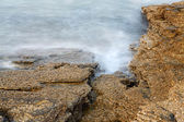 Aegean shore in Greece, Thassos island - waves and rocks - long exposure photography — Stock Photo