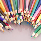 Group of colored pencils with white background and reflexions — Stockfoto