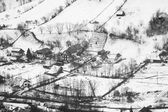 Winter mountain landscape with villages. Black and white photography — Stock Photo