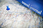 Travel journal on map — Stock Photo
