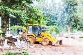 Excavator loading dumper truck tipper in construction site — Stock Photo