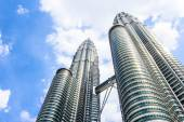 Cloudscape view of the Petronas Twin Towers at KLCC City Center — Stock Photo