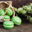 Green macaroons on dark wooden background — Stock Photo #59706857