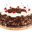 Black forest cake decorated with whipped cream and cherries — Stock Photo #59707031
