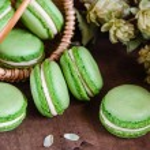 Green macaroons on dark wooden background — Stock Photo #61906019