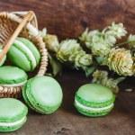 Green macaroons on dark wooden background — Stock Photo #61906023