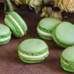 Green macaroons on dark wooden background — Stock Photo #61906025