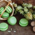 Green macaroons on dark wooden background — Stock Photo #61906033