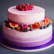 Two tiered purple cake with fruit on dark gray background — Stock Photo #61906075