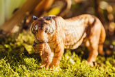 Tigress with cub in teeth. Tiger toy figurine in situation. — Stock Photo