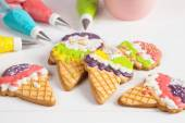 Colorful ice cream cone shape icing cookies — Stock Photo