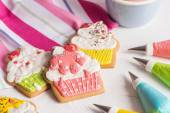 Colorful icing cookies in cupcake shape — Stock Photo