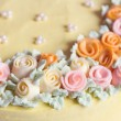 Close up pastel colored cream flowers cake decoration — Stock Photo #65981497