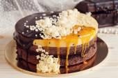Romaantic cake with chocolate glaze, cream flowers and  mango pa — Stock Photo