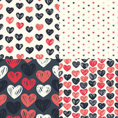 Seamless patterns with colorful hearts — Stockvektor