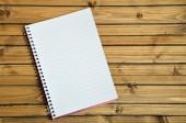 Empty notebook on table — Stockfoto