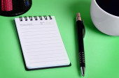 Cup of coffee and jotter — Stock Photo