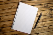 Empty notebook and pen — Stock Photo