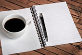 Notepad with coffee cup — Stok fotoğraf