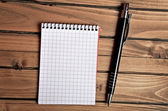 Empty notepad and pen — Stock Photo