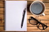 Notebook und Kaffee Tasse — Stockfoto