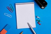 Empty notebook with office supply on background — Stock fotografie