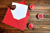 Red envelope with white paper on table — Stock Photo