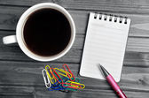 Empty notepad with coffee — Stock Photo