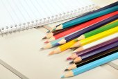 Colorful pencil with notepad — Stock Photo