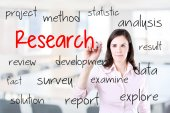 Young business woman writing research concept. — Stock Photo