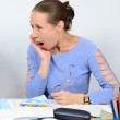 Astonished woman teacher at his desk — Stock Photo #54930925