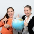 Schoolgirl teenager and a woman teacher with globe happy successful learning — Stock Photo #56168539