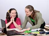 Teacher woman posing schoolgirl teen good grade, girl rejoices — Stock Photo
