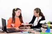 Woman teacher scolds teen schoolgirl due to poorly executed work — Stock Photo