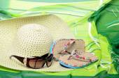 Beachfront set for summer vacation sandals, sunglasses, hat and pareo in still life — Stock Photo