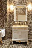 Interior of a bathroom in retro style - bath, mirror and cupboard with washbasin — Stock Photo