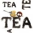 The word tea, tea leaves lined with letters and serving tea drinking with sugar and lemon in a still life on a white background. — Stock Photo #65901627