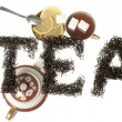 The word tea, tea leaves lined with letters and serving tea drinking with sugar and lemon in a still life on a white background. — Stock Photo #65901629