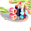 Antique gilded mirror, cosmetics for women's makeup and tulip flowers on a white background — Stock Photo #67648959