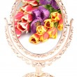 Bouquet of flowers tulips are reflected in the old gilded mirror on a white background — Stock Photo #68037881