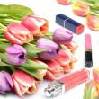 Cosmetics for women's makeup lipstick, lip gloss and tulip flowers on a white background — Stock Photo #69826605