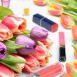 Colorful flowers tulips and items of makeup and cosmetics for women on a white background — Stock Photo #70205827