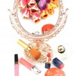 Antique gilded mirror reflecting a bouquet of flowers tulips and women's cosmetics and makeup on a white background — Stock Photo #70206359