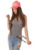 Beautiful brown-haired woman in a cap and jeans  — Photo
