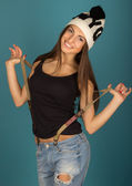 Beautiful brown-haired woman in winter hat and jeans — Photo