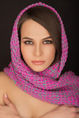 Portrait of beautiful girl with a scarf on her head  — Stock Photo