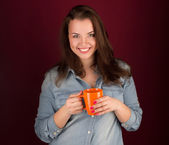 Beautiful smiling girl with a cup — Stock Photo
